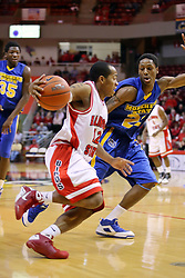 06 December 2008: Lloyd Phillips reaches out to keep control of the ball while running the baseline against Demonte Harper during a game where the  Illinois State University Redbirds extended their record to 9-0 with a 76-70 win over the Eagles of Morehead State on Doug Collins Court inside Redbird Arena on the campus of Illinois State University in Normal Illinois