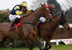 Chef D'Equipe and Mr David Maxwell (right)get the better of Masterplan and Jonathan Burke to go n and win The 32Red Handicap Steeple Chase Race run during 32Red Day at Sandown Park, Sandown.