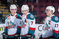 KELOWNA, CANADA - MARCH 1: Rodney Southam #17, Kole Lind #16 and Lucas Johansen #7 of the Kelowna Rockets share a laugh on the ice against the Prince George Cougars on MARCH 1, 2017 at Prospera Place in Kelowna, British Columbia, Canada.  (Photo by Marissa Baecker/Shoot the Breeze)  *** Local Caption ***