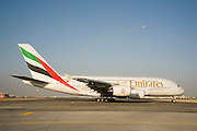 Dubai 2005, 9th International Aerospace Exhibition..First appearance of the new Airbus A380 in the Middle East and in the livery of its biggest buyer Emirates Airlines (45 planes ordered to date). Taxiing for takeoff. A Swedish JAS Gripen fighter performing in the background.