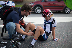 An exhausted Lotta Lepistö (FIN) of Cervélo-Bigla Cycling Team sits on the ground after finishing in second place in the 141 km road race of the UCI Women's World Tour's 2016 Crescent Vårgårda women's road cycling race on August 21, 2016 in Vårgårda, Sweden. (Photo by Balint Hamvas/Velofocus)