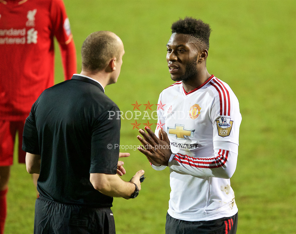 BIRKENHEAD, ENGLAND - Friday, March 11, 2016: Manchester United's Tim Fosu-Mensah is shown a yellow card by the referee during the Under-21 FA Premier League match against Liverpool at Prenton Park. (Pic by David Rawcliffe/Propaganda)