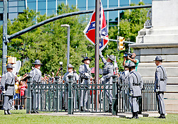 "Thousands gather to watch as members of the South Carolina Highway Patrol honor guard take down the Confederate battle flag Friday, July 10, 2015 at the Statehouse in Columbia. zlaup ""Confederate Flag"""