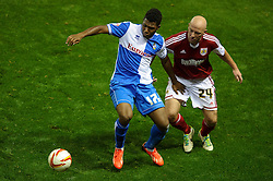 Bristol Rovers Forward Ellis Harrison (WAL) is challenged by Bristol City Defender James O'Connor (ENG) during the second half of the match - Photo mandatory by-line: Rogan Thomson/JMP - Tel: 07966 386802 - 04/09/2013 - SPORT - FOOTBALL - Ashton Gate, Bristol - Bristol City v Bristol Rovers - Johnstone's Paint Trophy - First Round - Bristol Derby