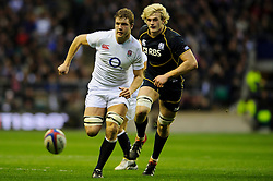 England Lock (#4) Joe Launchbury (London Wasps) and Scotland Lock (#4) Richie Gray (Sale Sharks) compete for a loose ball during the first half of the match - Photo mandatory by-line: Rogan Thomson/JMP - Tel: Mobile: 07966 386802 02/02/2013 - SPORT - RUGBY UNION - Twickenham Stadium - London. England v Scotland - 2013 RBS Six Nations Championship. The winner of this fixture is awarded the Calcutta Cup.