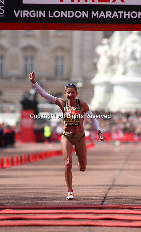 22.04.2012 London, England. Constantina Dita (Romania) crossing the finish-line at the 2012 Womens Virgin London Marathon.