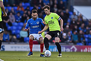 Portsmouth Midfielder, Ben Close (33) and Peterborough United Midfielder, Alex Woodyard (4) during the EFL Sky Bet League 1 match between Portsmouth and Peterborough United at Fratton Park, Portsmouth, England on 30 April 2019.