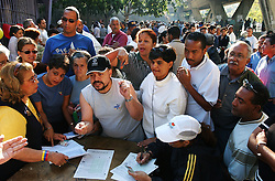 Opponents of President Chavez line up to sign a pettion asking for a recall referendum.