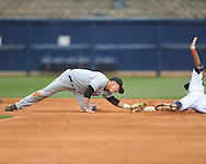Ole Miss' Errol Robinson (6) is safe at second against Arkansas-Pine Bluff second baseman Mitch Bruckshaw at Oxford-University Stadium in Oxford, Miss. on Wednesday, April 2, 2014.