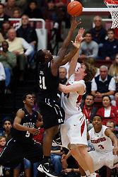 Dec 22, 2011; Stanford CA, USA;  Butler Bulldogs forward Roosevelt Jones (21) shoots over Stanford Cardinal forward/center John Gage (40) during the first half at Maples Pavilion.  Mandatory Credit: Jason O. Watson-US PRESSWIRE