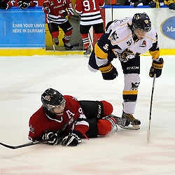 WHITBY, ON - Feb 2: Ontario Junior Hockey League game between Mississauga Chargers and Whitby Fury. Dakota Kettrick 55 of the Whitby Fury Hockey Club makes the hit on Lucas Venuto #90 of the Mississauga Chargers Hockey Club during third period game action.<br /> (Photo by Shawn Muir / OJHL Images)