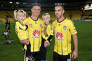 Phoenix's Ben Sigmund (Centre L) holding his children with team mate Manny Muscat (R after their last game for the Phoenix during the A-League - Wellington Phoenix v Western Sydney football match at Westpac Stadium in Wellington on Sunday the 10 April 2016. Copyright Photo by Marty Melville / www.Photosport.nz