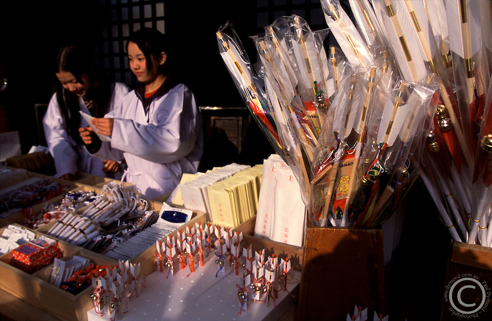 Young Shrine attendants sell good luck charms at Hokkaido's largest Shinto Shrine - Hokkaido Jingu.