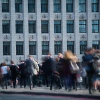London, UK - 1 September 2014: cummuters cross London Bridge during the morning rush hour