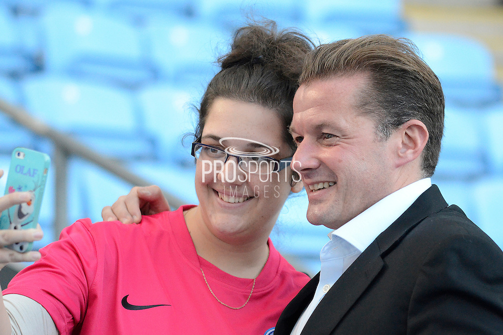 Peterborough United Manager Graham Westley  has a selfie with a fan during the Sky Bet League 1 match between Coventry City and Peterborough United at the Ricoh Arena, Coventry, England on 31 October 2015. Photo by Alan Franklin.
