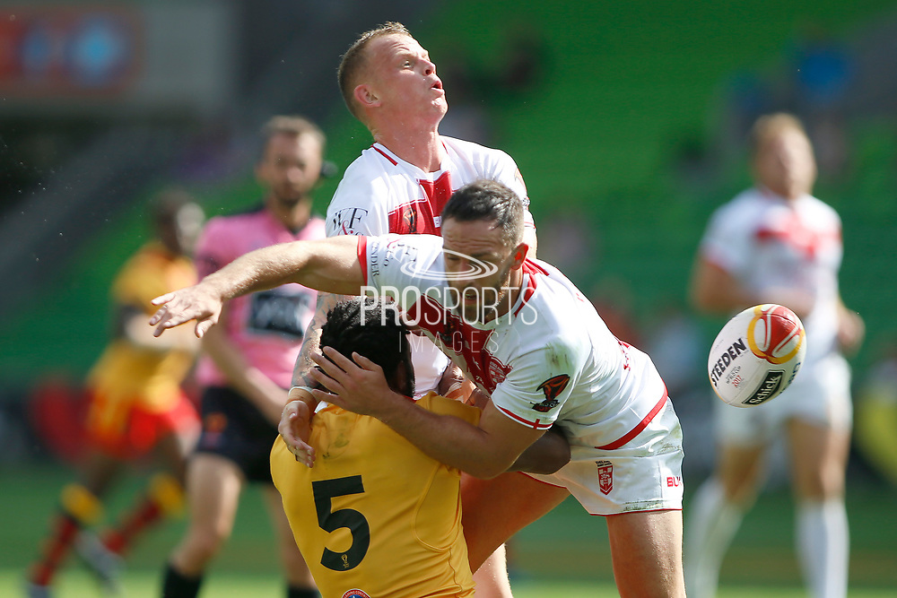 Josh Hodgson of England takes Garry Lo of Papua New Guinea head of with a high arm during the Rugby League World Cup Quarter-Final match between England and  Papua New Guinea at Melbourne Rectangular Stadium, Melbourne, Australia on 19 November 2017. Photo by Mark  Witte.