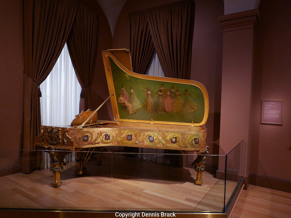 A Steinway and Sons piano commissioned by President Theodore Roosevelt for the White House.  The piano  was supposed to portray a patiotic pride.  Steinway and Sons commissoned artist Thomas Wilmer Dewing who painted  &quot;America receive the nine muses&quot; Date 1903.<br /> Photo by Dennis Brack