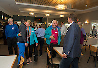 Laconia Country Club President Tim James greets members during Thursday evenings reception in their newly renovated bar and restaurant.   (Karen Bobotas/for the Laconia Daily Sun)