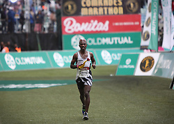 10062018 (Durban) A 8th position David Gatebe, RSA, (5:42:43) run towards the finnish line during the 2018 Comrades marathon in Durban.<br /> Picture: Motshwari Mofokeng/ANA