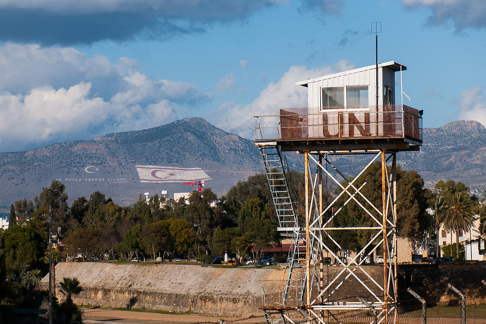 A guard tower with the turkish and the turkish cypriot flags in the UN buffer zone in Nicosia, Cyprus.<br /> Nicosia was divided into the southern Greek Cypriot and the northern Turkish Cypriot parts in 1963, following the intercommunal violence that broke out in the city. Today, the northern part of the city is the capital of Northern Cyprus, a de facto state that is considered to be occupied Cypriot territory by the international community. &copy;Simone Padovani / Awakening