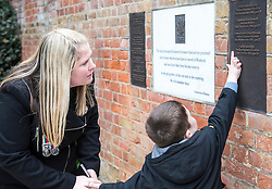 © London News Pictures. Rebecca Rigby the widow of Fusilier Lee Rigby and their son Jack at the new memorial in St George's Chapel, Woolwich. A new memorial to those from the Borough who lost their lives in Service since the end of WW2.  Fusilier Rigby is one of eleven men named on the memorial in the ruins of the Royal Artillery Garrison Church. Photo credit: Rupert Frere/LNP