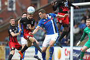 Chris Stokes heads clear under pressure from Harrison McGahey during the EFL Sky Bet League 1 match between Rochdale and Coventry City at Spotland, Rochdale, England on 17 April 2017. Photo by Daniel Youngs.