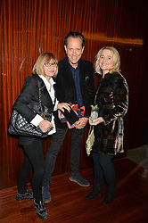 Left to right, JOAN WASHINGTON, RICHARD E GRANT and SINEAD CUSACK at a dinner hosted by Liberatum to honour Francis Ford Coppola held at the Bulgari Hotel & Residences, 171 Knightsbridge, London on 17th November 2014.