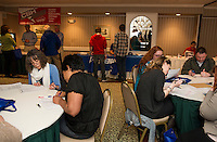 Applications filled out by job seekers and a chance to connect with local businesses at the Lakes Region Job Fair held at the Margate Conference Center on Wednesday afternoon.  (Karen Bobotas/for the Laconia Daily Sun)