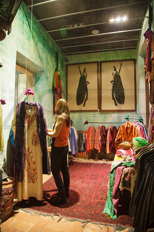 """A lady testing clothes at """"Lost In"""", an India-inspired shop and restaurant."""