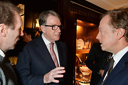 Left to right, LORD MANDLESON and GEORDIE GREIG at a party to celebrate the publication of 'A Designer's Life' by Nicky Haslam held at Ralph Lauren, 1 New Bond Street, London on 19th November 2014.