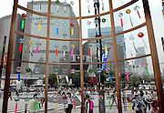 People walk past a display of Edo furin, or glass wind chimes, at a main junction in the Ginza district of Tokyo, Japan. The traditional chimes, which were until not long ago carried around town by sellers on bamboo poles, date back more than 200 years in Japan. Today there are but a handful of makers left in Japan, with cheaper imports from Korea and China gaining the lion's share of the business for these popular summer decorations. Shinohara' Furinhonpo has been in operation for over 100 years. The family-run business makes around 200,000 of the chimes a year.