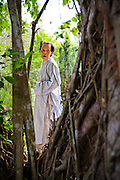 A woman prays in the brush, Chua Dieu Vien Pagoda, Hue, Vietnam.  Photo by Stan Olszewski/SOSKIphoto