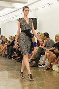 Gray beaded dress. By Carmen Marc Valvo at the Spring 2013 Fashion Week show in New York.