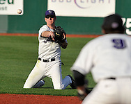MANHATTAN, KS - APRIL 22:  Second basemen Brett Scott (L) of the Kansas State Wildcats throws to first basemen Justin Bloxom #9 from his knees in the first inning against the UC Irvine Anteaters on April 22, 2008 at Tointon Stadium in Manhattan, Kansas.  UC Irvine defeated Kansas State 4-3.  (Photo by Peter Aiken/Getty Images)