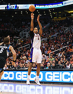 Apr. 11, 2011; Phoenix, AZ, USA; Phoenix Suns forward Channing Frye (8) puts up a shot against the Minnesota Timberwolves at the US Airways Center. The Suns defeated the Timberwolves 135 -127 in overtime. Mandatory Credit: Jennifer Stewart-US PRESSWIRE..