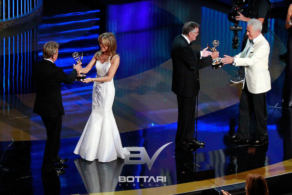 From left, Pat Sajak and Alex Trebek accept the Lifetime Achievement Award onstage from Vanna White and Peter Marshall during the Daytime Emmy Awards on Sunday June 19, 2011 in Las Vegas. (AP Photo/Jeff Bottari)