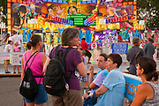 "01 SEPTEMBER 2011 - ST. PAUL, MN:  People in front of the Techno Tower ride on the midway at the Minnesota State Fair. The Minnesota State Fair is one of the largest state fairs in the United States. It's called ""the Great Minnesota Get Together"" and includes numerous agricultural exhibits, a vast midway with rides and games, horse shows and rodeos. Nearly two million people a year visit the fair, which is located in St. Paul.  PHOTO BY JACK KURTZ"