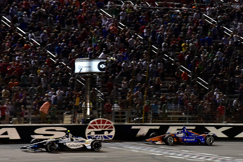 Scott Dixon, Chip Ganassi Racing Honda, crosses the finish line under the checkered flag for the win