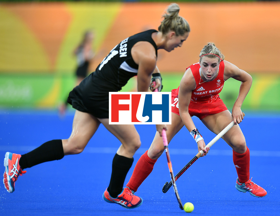 New Zealand's Stacey Michelsen (L) and Britain's Lily Owsley vie for the ball during the women's semifinal field hockey New Zealand vs Britain match of the Rio 2016 Olympics Games at the Olympic Hockey Centre in Rio de Janeiro on August 17, 2016. / AFP / MANAN VATSYAYANA        (Photo credit should read MANAN VATSYAYANA/AFP/Getty Images)