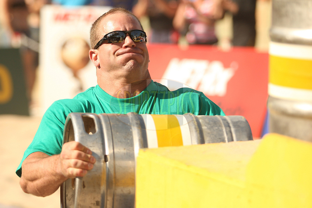 Jason Bergmann (USA) gets ready to place the heavy keg on the platform during one of the qualifying rounds of the World's Strongest Man competition held in Sun City, South Africa.