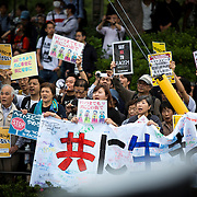KAWASAKI, JAPAN - JUNE 05: A anti-racist group holding a placards as some fascist and racist groups clash with anti-fascist and anti-racist as they try to disrupt an Counter-Racist protest in Nakahara Peace Park, Kawasaki City, Kanagawa prefecture, Japan on June 5, 2016. A district court in Kanagawa Prefecture has issued a first-ever provisional injunction preventing an anti-Korean activist from holding a rally near the premises of a group that supports ethnic Korean people.<br /> <br /> Photo: Richard Atrero de Guzman