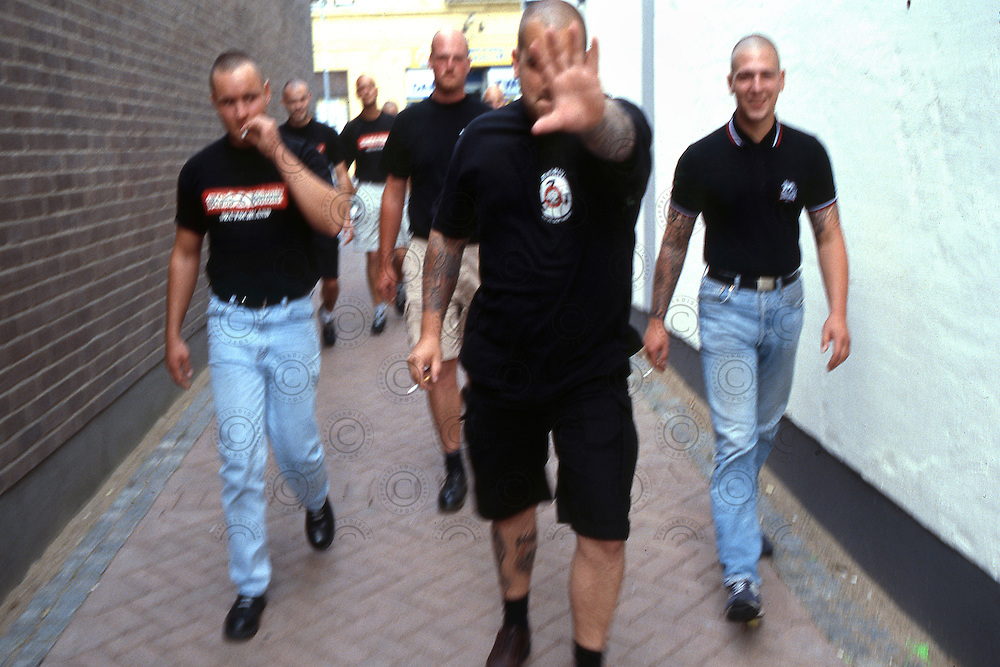 "Members of "" Blood & honnour Deutschland "" walks in the city."