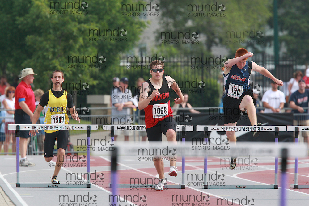 (London, Ontario}---05 June 2010) Dylan Ciccarelli of Malvern - Toronto competing in, Daniel Vandervoort of Bearcreek - Barrie competing in, Mike Schinkel of Ridgeway-Crystal - Ridgeway competing in the 300m / 400m hurdles at the 2010 OFSAA Ontario High School Track and Field Championships in London, Ontario, June 05, 2010 . Photograph copyright Dave Chidley / Mundo Sport Images, 2010.