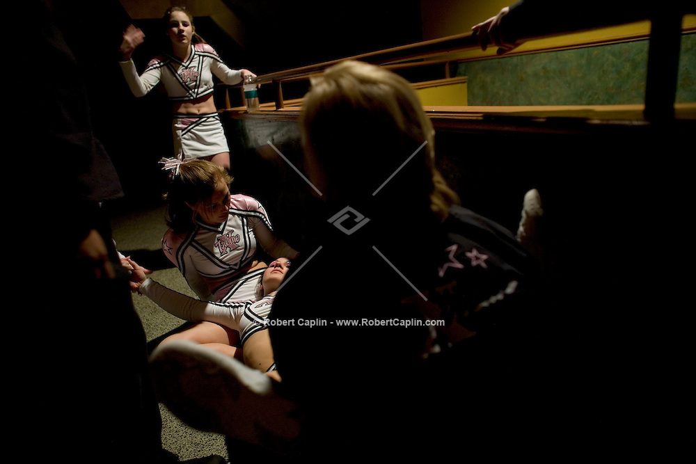 Samantha Boylan, 17,  of Xtreme All-Stars Pink Chicas, faints with exhaustion after competing in the NCA/NDA U.S. Championship held at the Hammerstein Ballroom Sat. March 10, 2007. Rising popularity in the sport of cheerleading has brought a significant increase in cheerleading related accidents and injuries.