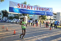 BELLVILLE, SOUTH AFRICA - Wednesday 3 December 2014, Sythilo Diko coming in third place during the Metropolitan 10km road race outside the Parc Du Cap head office in Bellville.<br /> Photo by IMAGE SA / Roger Sedres