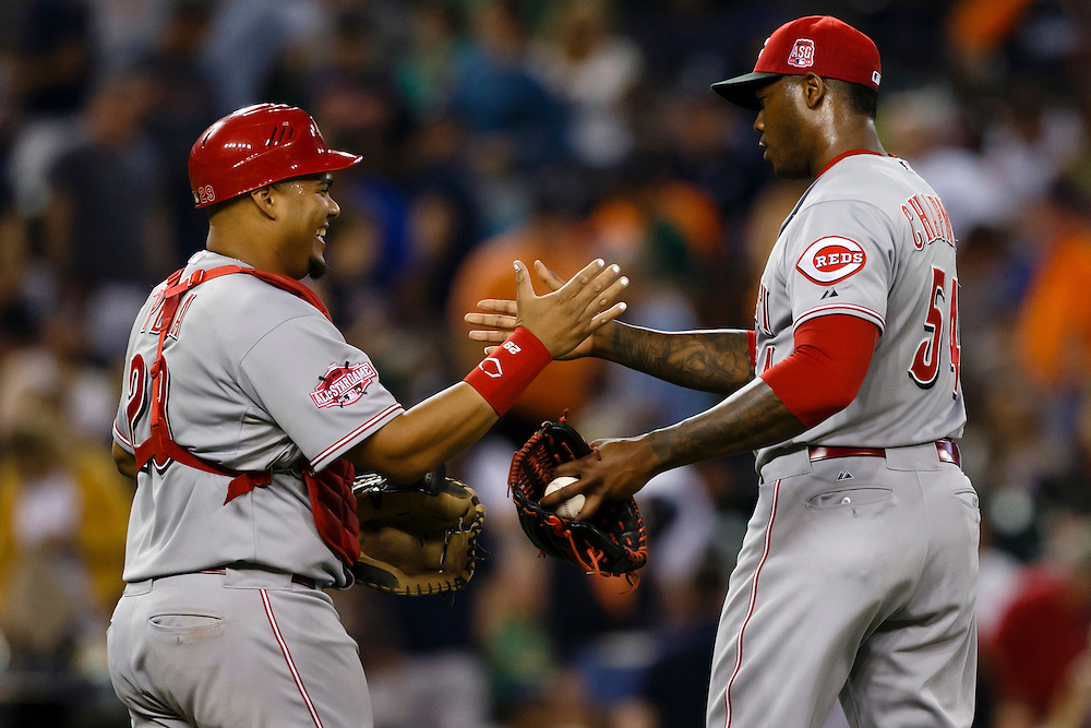 Jun 16, 2015; Detroit, MI, USA; Cincinnati Reds catcher Brayan Pena (29) and relief pitcher Aroldis Chapman (54) celebrate after the game against the Detroit Tigers at Comerica Park. Cincinnati won 5-2. Mandatory Credit: Rick Osentoski-USA TODAY Sports