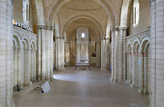 Nave, aerial view, of the Romanesque abbey church of Fontevraud Abbey, Fontevraud-l'Abbaye, Loire Valley, Maine-et-Loire, France. In the centre are the 12th century effigies of Henry II, 1133-89, Plantagenet King of England and his wife, Eleanor of Aquitaine 1122-1204, King Richard I the Lionheart (reigned 1189-99) and Isabelle d'Angouleme. Behind them are the apse, choir and ambulatory. The abbey itself was founded in 1100 by Robert of Arbrissel, who created the Order of Fontevraud. It was a double monastery for monks and nuns, run by an abbess. The abbey is listed as a historic monument and a UNESCO World Heritage Site. Picture by Manuel Cohen