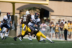 Virginia linebacker Clint Sintim (51) pursues Wyoming running back Wynel Seldon (31).  The Wyoming Cowboys defeated the Virginia Cavaliers 23-3 at War Memorial Stadium in Laramie, WY on September 1, 2007.