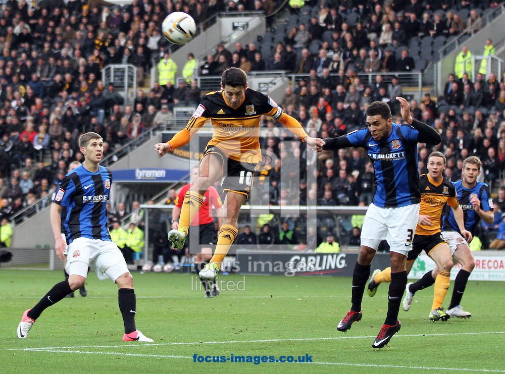 Picture by Richard Gould/Focus Images Ltd +44 7855 403186.03/11/2012.Robert Koren(C) of Hull City out jumps everybody but his header is saved during the npower Championship match at the KC Stadium, Kingston upon Hull.