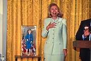 Hillary Clinton views a Hillary Doll gifted her by the Hillary Clinton Fan Club during the first White House gathering in the East Room in Washington, DC.